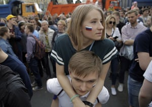 Dozens of protesters attend a demonstration in downtown Moscow