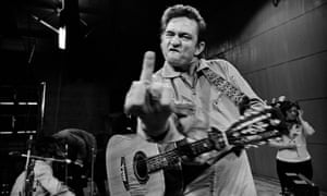Sneering … Johnny Cash photographed by Jim Marshall at San Quentin prison, 1969