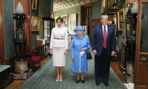 Queen Elizabeth II stands with Donald Trump and his wife, Melania, inside Windsor Castle.