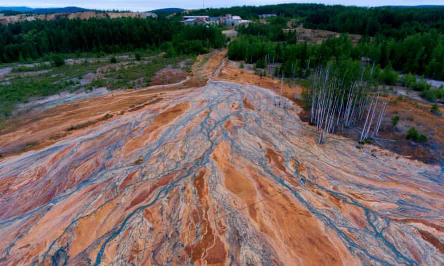 Orange-coloured water near a disused copper-sulphide mine