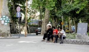 Migrants sit by the park in Bihać