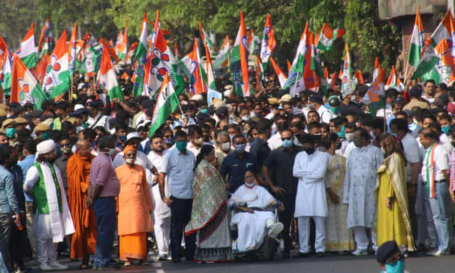 Mamata Banerjee, in a wheelchair, is leading a campaign march in Kolkata.