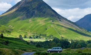 Range Rover 4x4 vehicle by Wasdale Fell and Wastwater in the Lake District National Park, Cumbria,