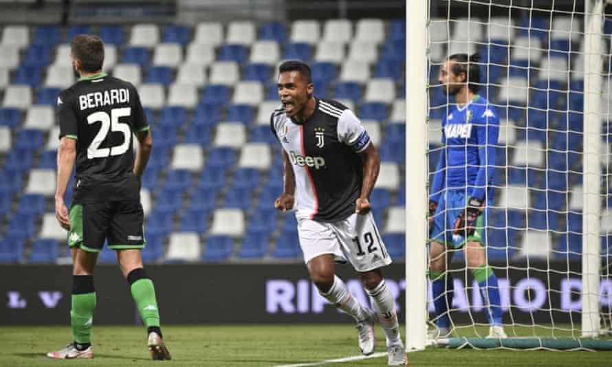 Alex Sandro celebrates his equaliser for Juventus at Sassuolo.