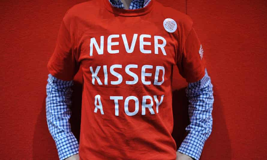 A Labour supporter wears a Never Kissed A Tory T-shirt