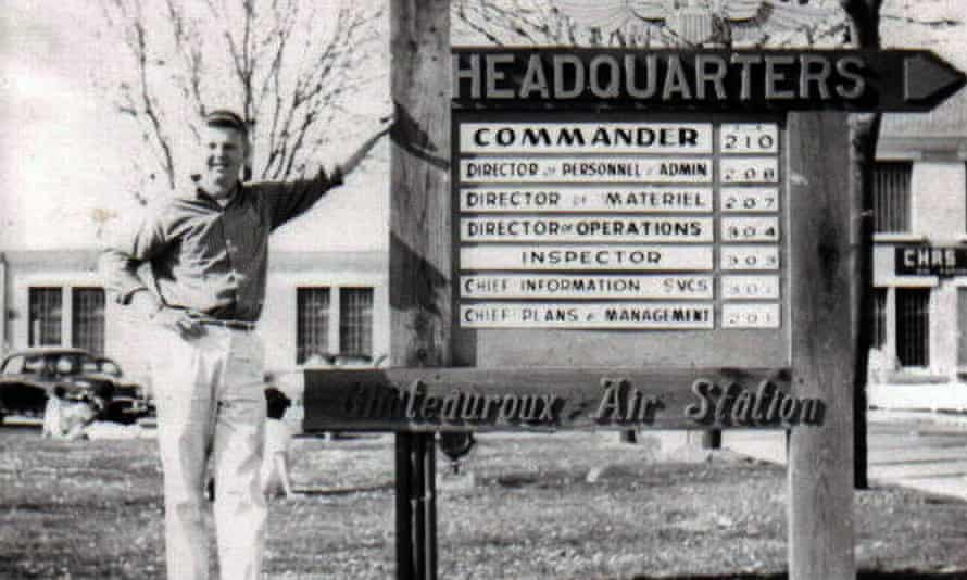 Man standing next to a sign at the Chateauroux air base in central France when the site was used as a base for NATO from 1951 to 1967.