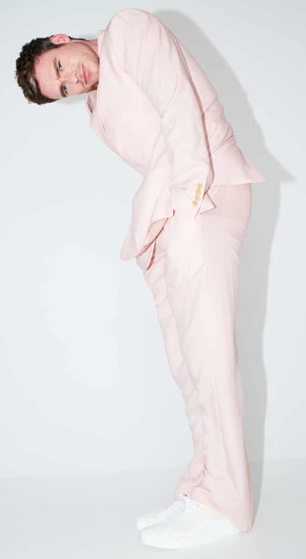 Actor Richard Madden in pink suit