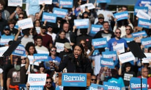 Alexandria Ocasio-Cortez speaks during a campaign rally for Bernie Sanders on Saturday.