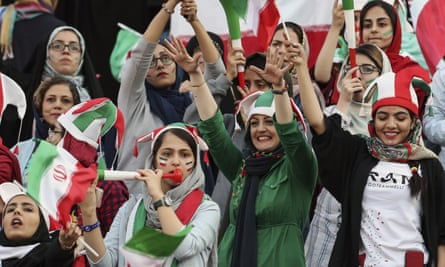 Female fans support the Iran football team against Cambodia in Tehran.