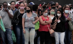 People wearing face masks walk the busy shopping streets of downtown Sao Paulo on December 10, 2020 in Sao Paulo, Brazil. According to the state of Sao Paulo, the risk of Covid-19 transmission is greater in December than in July during the first peak of the pandemic.
