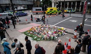 Flowers are pictured at the south-side of London Bridge opposite the Barrowboy and Banker pub