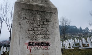 A memorial to the dead with the word 'genocide' reinstated by survivors.