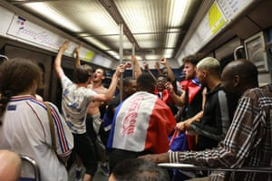 Fans celebrate on the subway in Paris