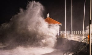 Storm Eleanor, the fifth named storm of the winter, hits Aberystwyth Wales, with westerly winds gusting up to 80mph bringing huge waves crashing against the sea defences at high tide