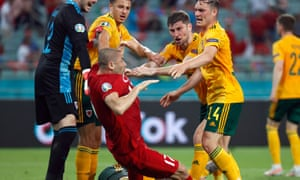 Connor Roberts and Ben Davies clash with Turkey's Burak Yilmaz as Wales' Danny Ward and Ethan Ampadu look on .