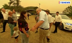 Scott Morrison tries to shake hands with unwilling woman in Cobargo