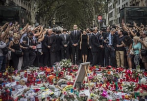 People take photos of King Felipe and Queen Letizia paying their respects at a memorial to victims of the terrorist attack on Las Ramblas promenade