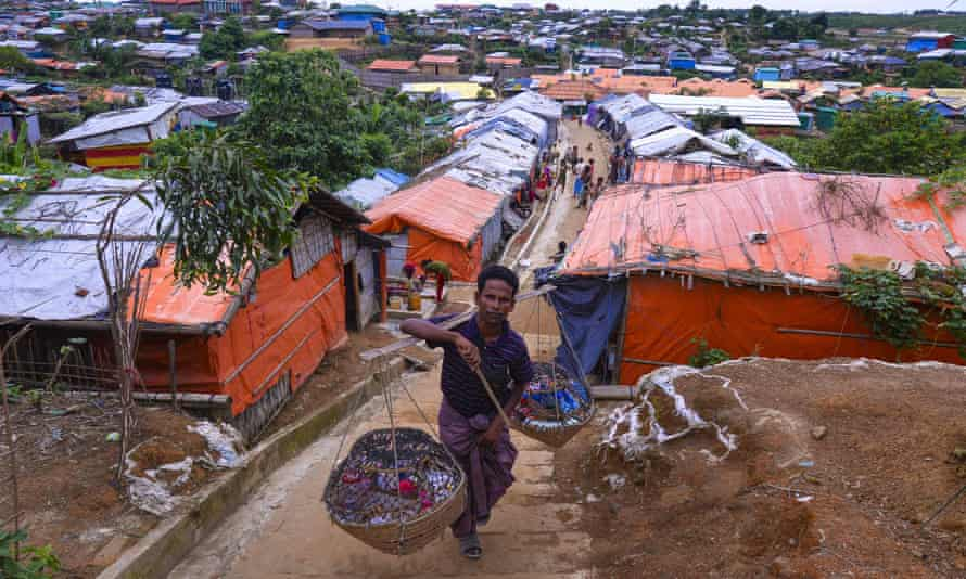 A Rohingya vendor walks around Kutupalong refugee camp in Bangladesh