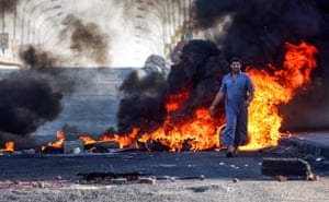 Protesters block the main road with burning tyres in Basra, Iraq