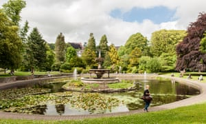 Young woman walks past the fountain in Fitzgerald's Park Cork