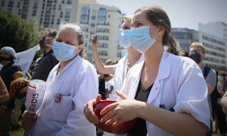 Medics in Paris protest against the government's handling of the coronavirus pandemic on Thursday.
