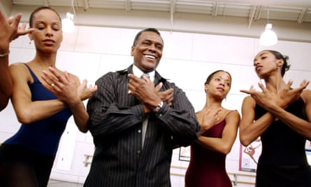Arthur Mitchell as artistic director of Dance Theatre of Harlem, with dancers after a class in 2003.