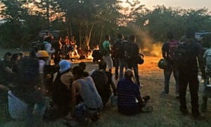 Refugees gather on the Greek-Macedonian border.
