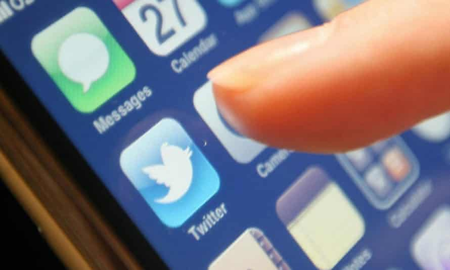 Smartphone showing finger about to click on Twitter app