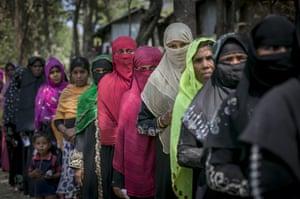 Women queue for food and hygiene supplies at Balu Khali refugee camp