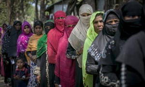 Rohingya refugees gather for aid supplies in Chittagong.