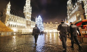 Belgian police officers patrol the Grand Place in Brussels