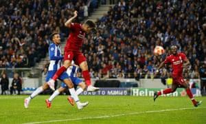Liverpool's Roberto Firmino scores their third goal.