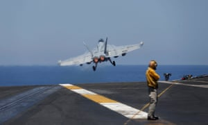 An F/A-18 fighter taking off from the USS Harry S Truman aircraft carrier in the eastern Mediterranean.