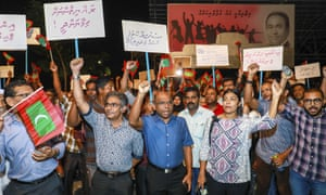 Opposition supporters in Malé protest the government's delay in following the supreme court order on Sunday.