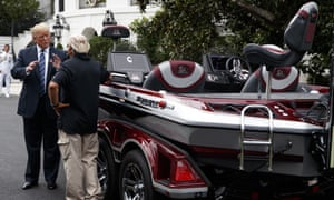 Trump talks with Jimmy Houston of Ranger Boats as he participates in a tour