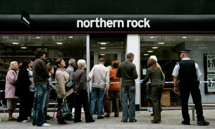 Customers queuing outside a branch of Northern Rock in September 2007.
