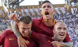 Roma's Edin Dzeko celebrates with his team-mates Leandro Paredes and Radja Nainggolan after his second goal at Napoli.