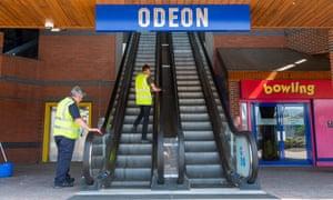 Cleaners on Odeon escalator