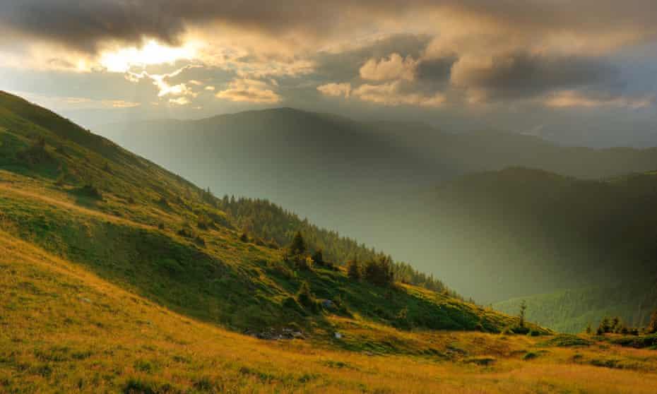 Landscape photograph of Carpathian Mountains, Romania in moody, evocative light.