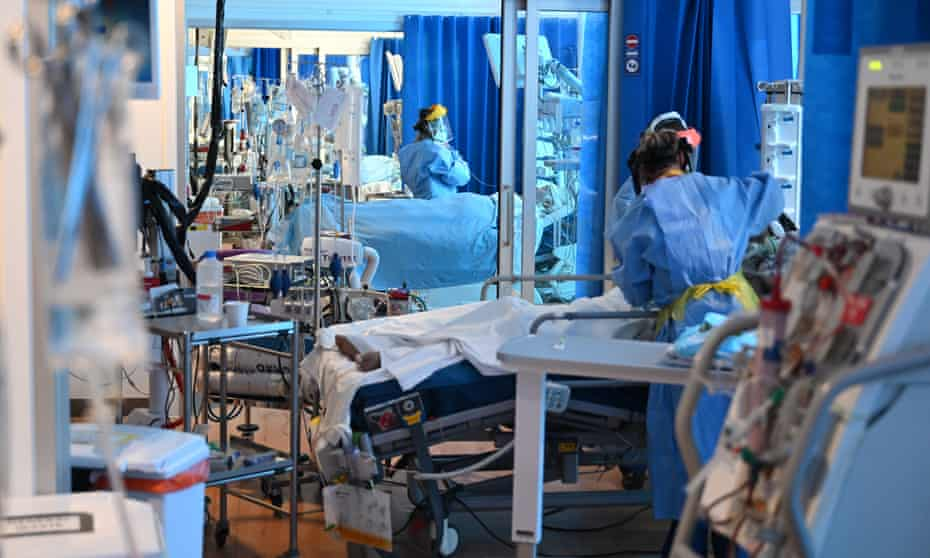 Clinical staff wear personal protective equipment (PPE) in an Intensive Care unit. BAME people are significantly disproportionately over-represented among the sickest coronavirus patients.