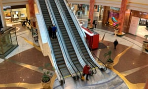 Shoppers are seen inside a deserted Intu Trafford Centre amid the coronavirus outbreak in Manchester.