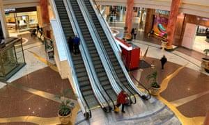 Shoppers inside the deserted Intu Trafford Centre during the coronavirus outbreak.