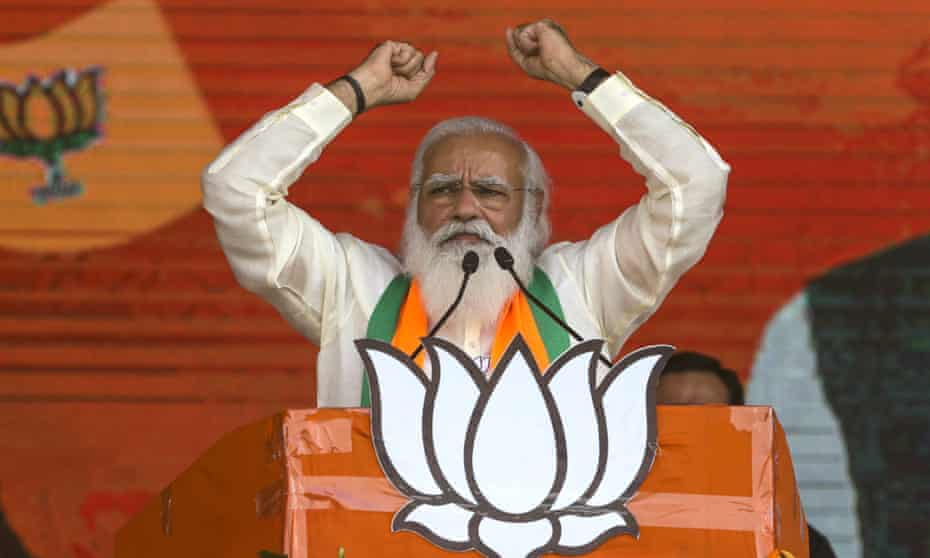India's prime minister, Narendra Modi, addresses a public rally in Kolkata, India, ahead of state elections.