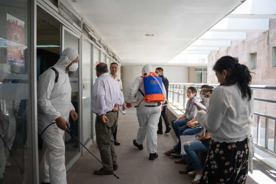 Council staff wait outside their offices while the building is cleaned in April 2020.