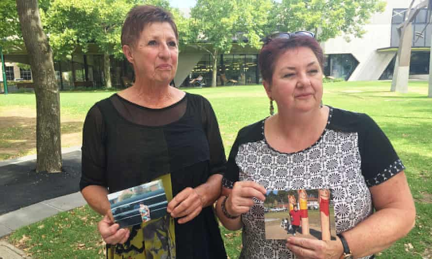 Helen Sculley and Pam White hold photos of their sister Christina Jenkins, who died in June 2017, one year after being admitted to an aged care centre in her early 50s.