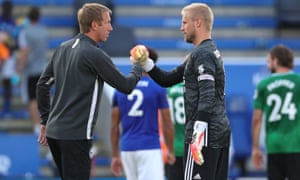 Brighton boss Graham Potter (left) greets Leicester keeper Kasper Schmeichel after the final whistle.