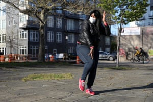 """Idrissa Morales, 38-years-old, dances on a sidewalk in Williamsburg, Brooklyn. """"I'm waiting for my husband to get off work. I needed to get my blood pumping and I am trying to learn a new Tik Tok dance. It's one of the new ones that everyone is doing, I had a five year old teach me. It's really easy to get depressed right now. I suffer from depression, so it's important that I'm active, even if it's just for ten minutes."""""""