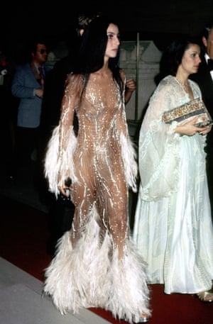 Cher looks ethereal in a see-through, sequinned, and feathered confection at the Met Gala,1974.