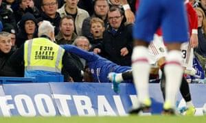 Chelsea's Callum Hudson-Odoi falls in to the stand.