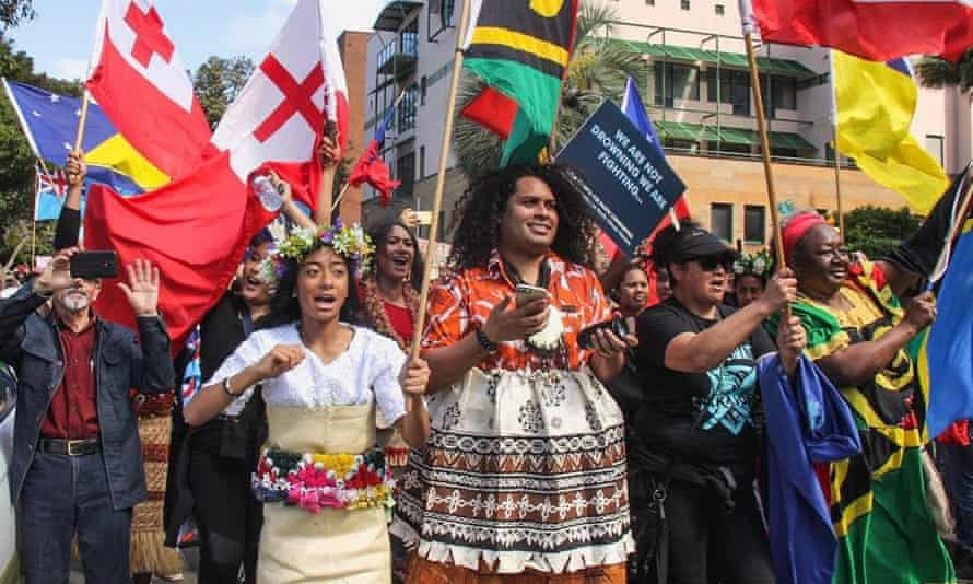 Members of 350 Pacific march at the global climate march in Sydney in September 2019.